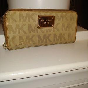 Michael Kors used wallet.  Beige / Tan